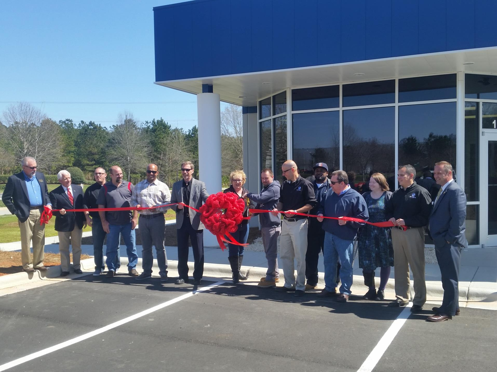 Stock America ribbon cutting